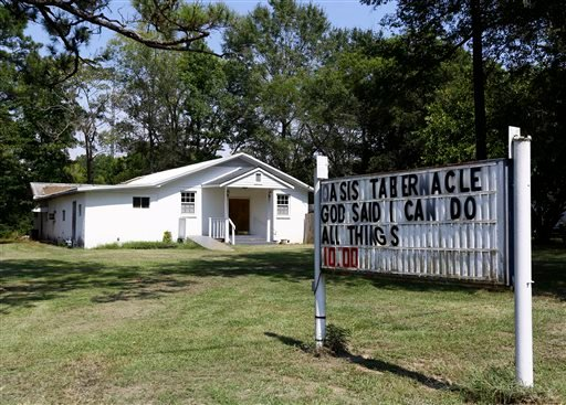 The Oasis Tabernacle Church is seen in East Selma, Ala., on Sunday, Sept. 20, 2015. Dallas County District Attorney Michael Jackson says suspect James Minter has been charged with three counts of attempted murder after allegedly shooting a woman, an infan