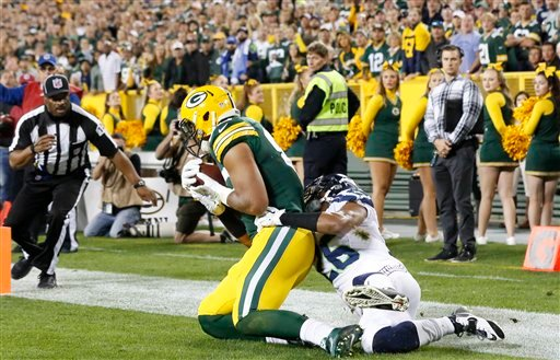 Green Bay Packers' Richard Rodgers catches a touchdown pass in front of Seattle Seahawks' Cary Williams during the second half of an NFL football game Sunday, Sept. 20, 2015, in Green Bay, Wis. (AP Photo/Mike Roemer)