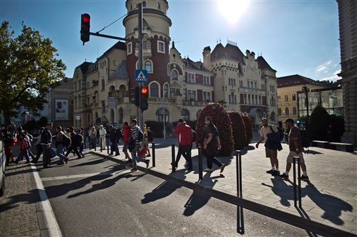 Migrants walk toward the train station to board a train in Celje, Slovenia, Monday, Sept. 21, 2015. Croatia has been under extreme pressure since thousands of asylum seekers got stuck there after Hungary shut its border last week. (AP Photo/Muhammed Muhei
