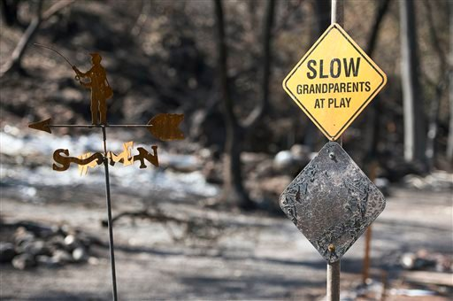 A scorched sign and homes remain on Thursday Sept. 17, 2015 in Anderson Springs, Calif. The Valley Fire that sped through Middletown and other parts of rural Lake County, less than 100 miles north of San Francisco, has continued to burn since Saturday des
