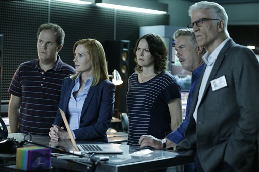 """In this image released by CBS, David Berman, from left, Marg Helgenberger, Jorja Fox, William Petersen and Ted Danson appear in a scene from the 2-hour series finale of """"CSI: Crime Scene Investigation""""."""