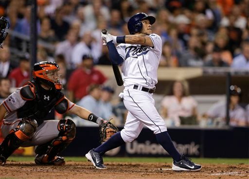 San Diego Padres' Alexi Amarista watches his single against the San Francisco Giants that drove in the winning run during the ninth inning of a baseball game Thursday, Sept. 24, 2015, in San Diego. The Padres won 5-4. (AP Photo/Gregory Bull)