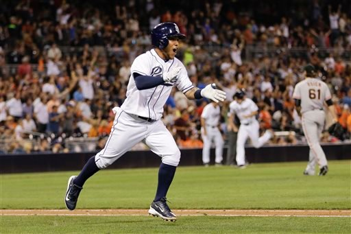 San Diego Padres' Alexi Amarista celebrates his walk-off single against the San Francisco Giants during the ninth inning of a baseball game Thursday, Sept. 24, 2015, in San Diego. The Padres won 5-4. (AP Photo/Gregory Bull)