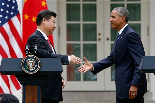 President Barack Obama shakes hands with Chinese President Xi Jinping after their joint new conference in the Rose Garden of the White House in Washington, Friday, Sept. 25, 2015.