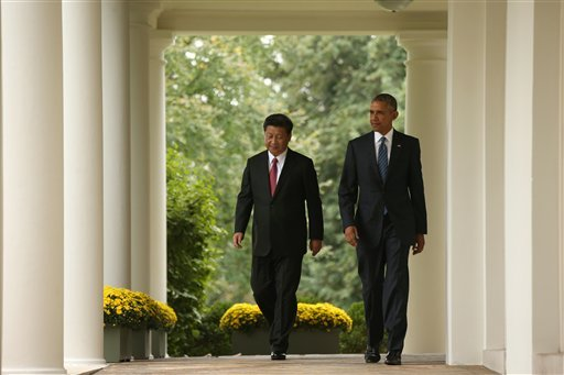 President Barack Obama and Chinese President Xi Jinping walk through the Colonnade of the White House in Washington, Friday, Sept. 25, 2015, for a news conference in the Rose Garden.