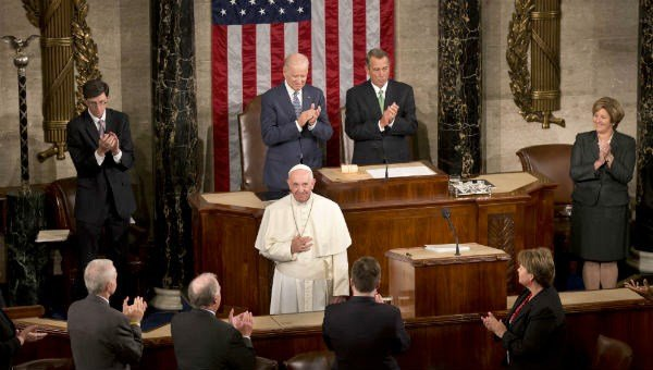 Pope Francis listens to applause before addressing a joint meeting of Congress on Capitol Hill in Washington, Thursday, Sept. 24, 2015, making history as the first pontiff to do so.
