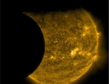 A total lunar eclipse will share the stage with a so-called supermoon Sunday evening, Sept. 27, 2015 as seen from the United States. That combination hasn't been seen since 1982 and won't happen again until 2033. (NASA/SDO via AP)