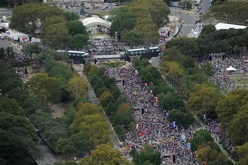 Crowds gathered at Benjamin Franklin Parkway for the Papal Mass on Sunday, June 27, 2015, in Philadelphia. Pope Francis is in Philadelphia for the last leg of his six-day visit to the United States. (AP Photo/Michael Perez)
