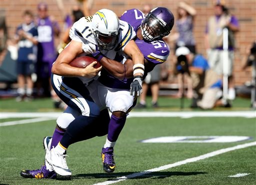 Minnesota Vikings defensive end Everson Griffen (97) sacks San Diego Chargers quarterback Philip Rivers (17) in the first half of an NFL football game in Minneapolis, Sunday, Sept. 27, 2015. (AP Photo/Jim Mone)