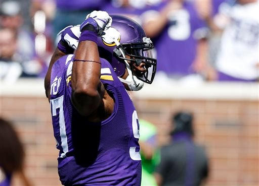 Minnesota Vikings defensive end Everson Griffen (97) celebrates a sack against San Diego Chargers quarterback Philip Rivers in the first half of an NFL football game in Minneapolis, Sunday, Sept. 27, 2015. (AP Photo/Jim Mone)