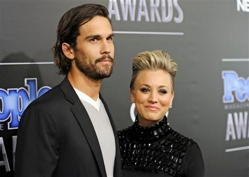 In this Dec. 18, 2014 file photo, Ryan Sweeting, left, and his wife Kaley Cuoco arrive at the People Magazine Awards at the Beverly Hilton in Beverly Hills, Calif.