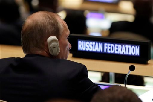 Russia's President Vladimir Putin listens to addresses in the 70th session of the United Nations General Assembly, Monday, Sept. 28, 2015. (AP Photo/Richard Drew)