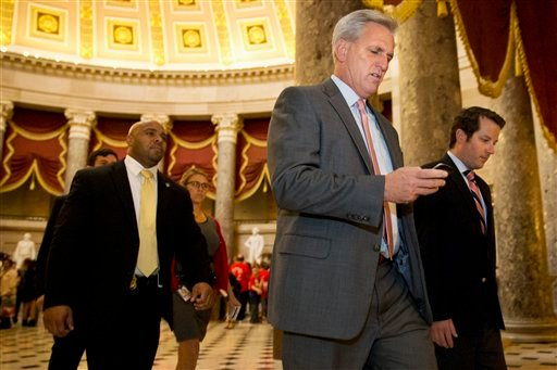 House Majority Leader Kevin McCarthy of Calif., center, walks to a procedural vote and debate in the House on a stopgap spending bill to avert a government shutdown, Wednesday, Sept. 30, 2015, on Capitol Hill in Washington. A temporary funding measure aim