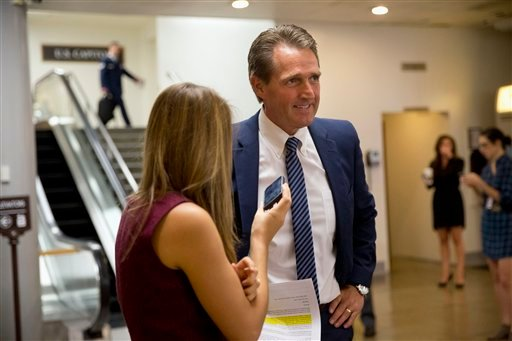 Sen. Jeff Flake, R-Ariz. speaks with a reporter on Capitol Hill in Washington, Wednesday, Sept. 30, 2015, after voting yes for a Senate approved stopgap spending bill to avert a government shutdown. The vote now goes to the House. (AP Photo/Jacquelyn Mart