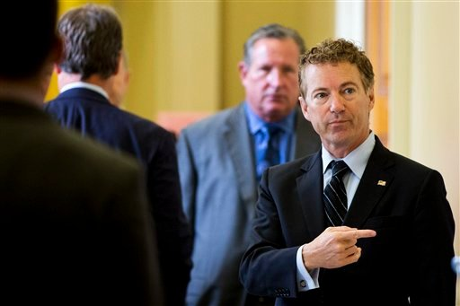 Republican presidential candidate, Sen. Rand Paul, R-Ky. points while talking with visitors on Capitol Hill in Washington, Wednesday, Sept. 30, 2015. A temporary funding measure that would keep the government open past a midnight deadline easily sailed th
