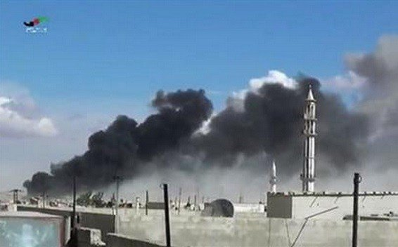 Russian military jets carried out airstrikes in Syria for the first time on Wednesday, targeting what Moscow said were Islamic State positions.  (Homs Media Centre via AP)