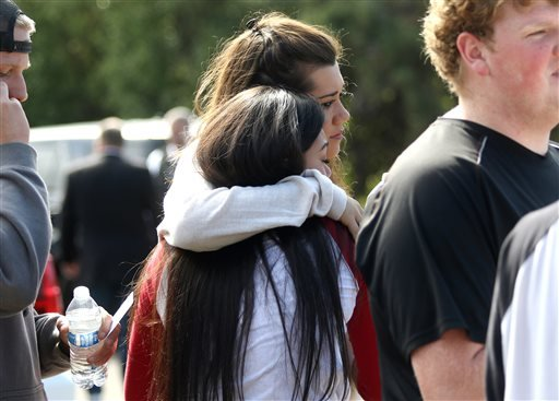 Umpqua Community College students react after a deadly shooting was reported on the campus in Roseburg, Ore., Thursday, Oct. 1, 2015. (Michael Sullivan /The News-Review via AP)