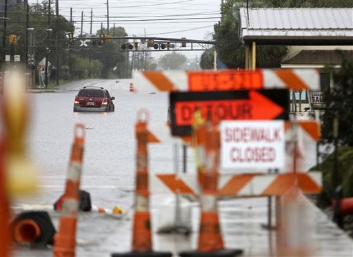 """Several cars are submerged in the flood throughout Georgetown, S.C., on Sunday, Oct. 4, 2015. The rainstorm drenching the East Coast brought more misery Sunday to South Carolina, cutting power to thousands, forcing hundreds of water rescues and closing """"t"""