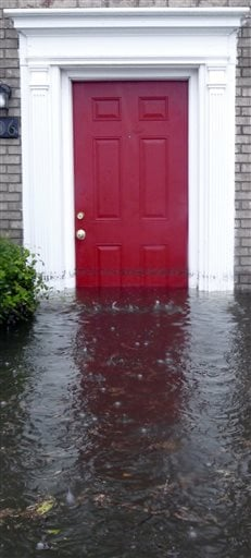 """Winyah Apartments is flooded in Georgetown, S.C., on Sunday, Oct. 4, 2015. The rainstorm drenching the East Coast brought more misery Sunday to South Carolina, cutting power to thousands, forcing hundreds of water rescues and closing """"too many roads to na"""