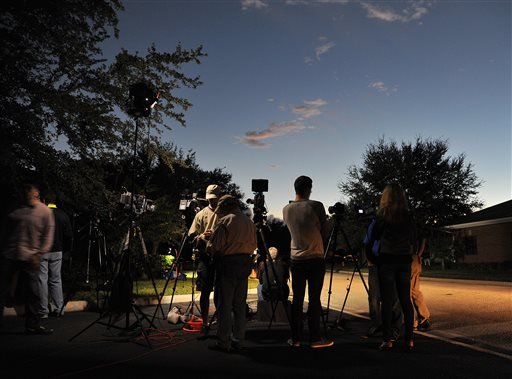 As the sun begins to set as television crews set up their lights while waiting for an update on the crew members aboard the missing cargo ship El Faro outside the Seafarer's International Union hall in Jacksonville, Fla., Sunday, Oct. 4, 2015. Authorities
