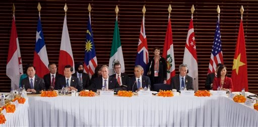 In this Nov. 10, 2014 file photo, U.S. President Barack Obama, center, speaks during his meeting with leaders of the Trans-Pacific Partnership countries, in Beijing. Sitting with Obama are, from left, Vietnam Minister of Industry and Trade Vu Hoy Hoang, V