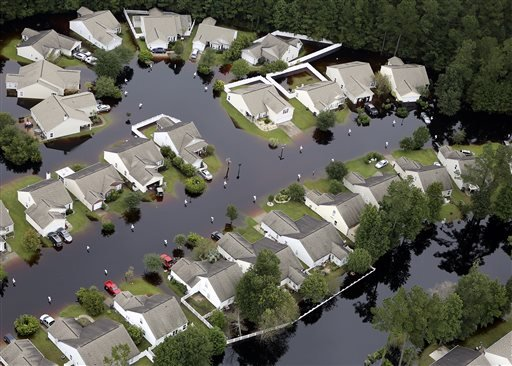 This aerial photo show flooding around homes in the Carolina Forest community in Horry County, between Conway and Myrtle Beach, S.C. The Carolinas saw sunshine Tuesday after days of inundation, but it could take weeks to recover from being pummeled by a h