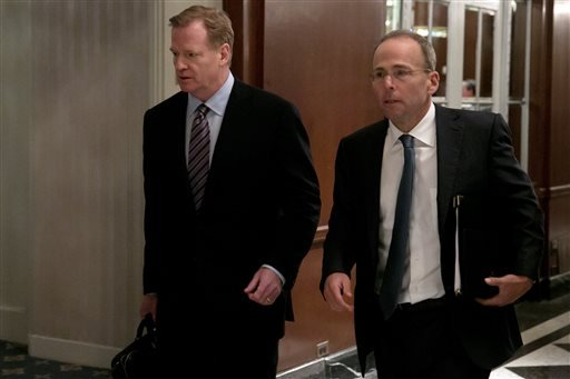 NFL Commissioner Roger Goodell, left, arrives during the National Football League owners meeting, in New York, Wednesday, Oct. 7, 2015.