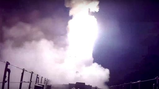 In this photo made from the footage taken from Russian Defense Ministry official web site, Wednesday, Oct. 7, 2015, a Russian navy ship launches a cruise missile in the Caspian Sea. Russia's Defense Minister Sergei Shoigu said four Russian navy ships in t