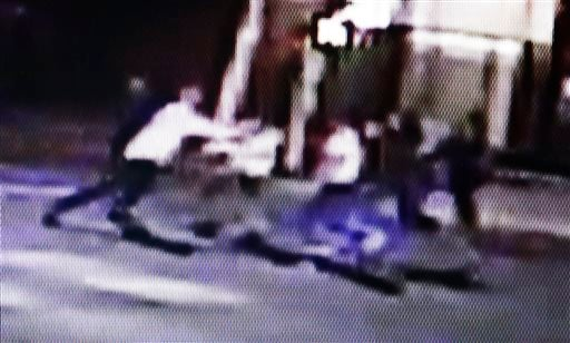 This frame from video provided by A&P Liquors, shows a group of people, including U.S. airman Spencer Stone, fighting outside a bar in Sacramento, Calif., in the early hours of Thursday, Oct. 8, 2015.