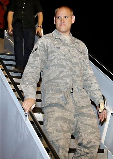 In this Sept. 3, 2015 file photo, U.S. Air Force Airman 1st Class Spencer Stone, one of three Americans who tackled a heavily armed gunman on a Paris-bound train on Aug. 21, arrives at Travis Air Force Base in Fairfield, Calif.