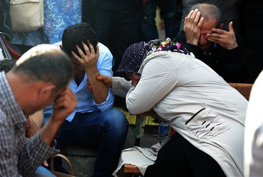 Relatives of people wounded at the explosions in Ankara, Turkey, react as they wait news for their loved ones outside a hospital, Saturday, Oct. 10, 2015. Two bomb explosions targeted a peace rally, organised by the country's public sector workers' trade