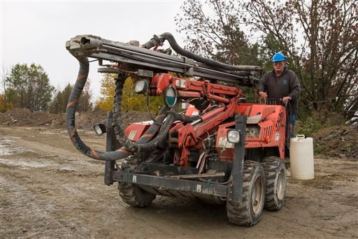 In this Friday, Oct. 9, 2015, photo, Glen Mead operates a line drill machine at a rock quarry, in Montrose, Pa. Mead spent his life working as a dairy farmer and at age 60, began working with Rock Ridge Stone in Montrose, to make ends meet. (AP Photo/Bret