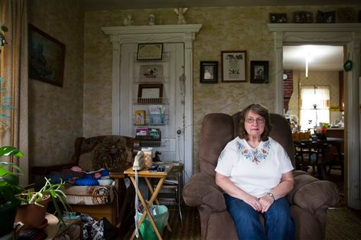 In this Friday, Oct. 9, 2015, photo, Carol Mead poses for a portrait at her home, in Montrose, Pa. Mead, 67, is retired and her husband, 70, must work at a local rock quarry to close the gap from her Social Security. For just the third time in 40 years, m