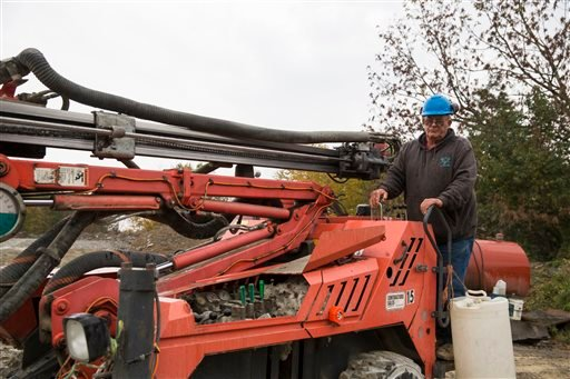 In this Friday, Oct. 9, 2015, photo, Glen Mead operates a line drill machine at a rock quarry, in Montrose, Pa. Mead spent his life working as a dairy farmer and at age 60, began working with Rock Ridge Stone in Montrose, to make ends meet. For just the t