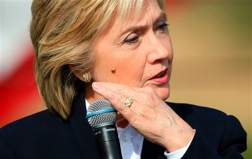 Democratic presidential candidate Hillary Rodham Clinton brushes off a lady bug that landed on her as she speaks Wednesday, Oct. 7, 2015, during a campaign stop at the Westfair Amphitheater in Council Bluffs, Iowa. (AP Photo/Nati Harnik)