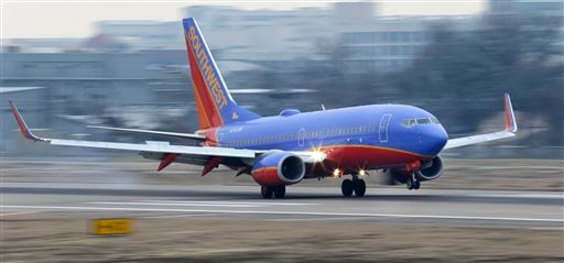 Feb. 3, 2014, file: Southwest Airlines jet lands at Love Field in Dallas. Southwest Airlines said Oct. 12, 2015, that it's fixed the technology problems and that it expects a normal day of operations. (AP Photo/LM Otero, File)