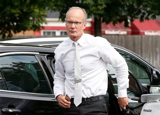 In this Tuesday, Sept. 8, 2015 file photo dentist Walter Palmer, arrives back at his office following a lunch break in Bloomington, Minn.