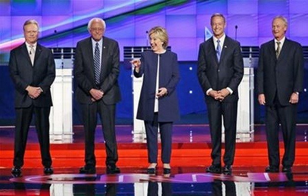 Democratic presidential candidates from left, former Virginia Sen. Jim Webb, Sen. Bernie Sanders, of Vermont, Hillary Rodham Clinton, former Maryland Gov. Martin O'Malley, and former Rhode Island Gov. Lincoln Chafee take the stage before the CNN Debate