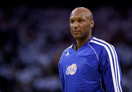This Jan. 2, 2013 file photo shows Los Angeles Clippers' Lamar Odom (7) in action against the Golden State Warriors during an NBA basketball game in Oakland, Calif.