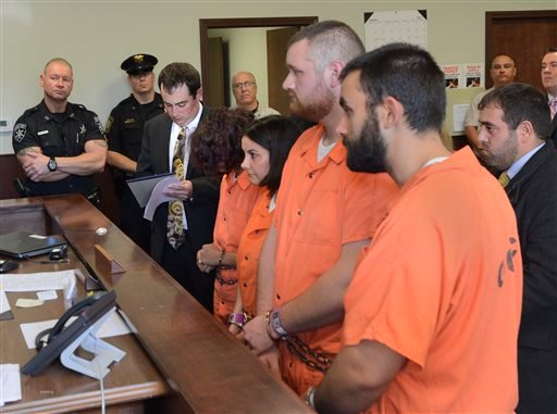 From left, Sarah Ferguson, 33, Linda Morey, 54, Joseph Irwin, 26, and David Morey, 26, are arraigned in front of Judge Bill M. Virkler after being charged with second-degree assault of 17-year-old Christopher T. Leonard, Teusday, Oct. 13, 2015.