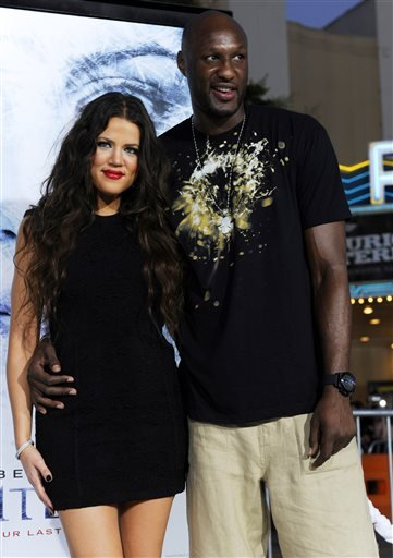 "In this Sept. 9, 2009 file photo, Khloe Kardashian and Los Angeles Lakers basketball player Lamar Odom pose together at the premiere of the film ""Whiteout"" in Los Angeles."
