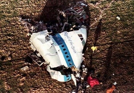 """In this Dec. 22, 1988 photo the nose section of Pan Am Flight 103, a 747 airliner dubbed """"The Maid of the Sea,"""" lies in a field outside the village of Lockerbie, Scotland. (AP)"""
