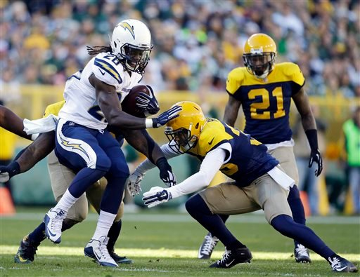 San Diego Chargers running back Melvin Gordon (28) is tackled by Green Bay Packers' Micah Hyde, front right, during the first half of an NFL football game Sunday, Oct. 18, 2015, in Green Bay, Wis. (AP Photo/Jeffrey Phelps)