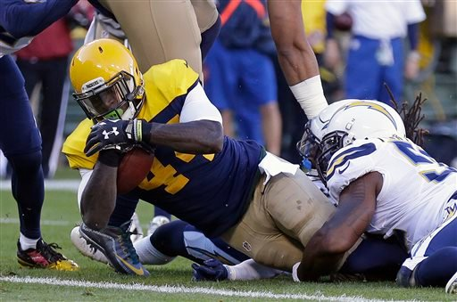 Green Bay Packers' James Starks (44) goes in for a five-yard touchdown reception as he is tackled by San Diego Chargers' Denzel Perryman during the first half of an NFL football game Sunday, Oct. 18, 2015, in Green Bay, Wis. (AP Photo/Jeffrey Phelps)