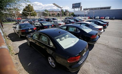 In this Sept. 23, 2015 file photo, Volkswagen diesel cars are parked in a storage lot near a VW dealership in Salt Lake City. (AP Photo/Rick Bowmer, File)
