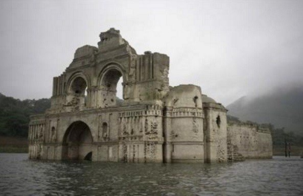 """The church was abandoned due the big plagues of 1773-1776,"" said architect Carlos Navarette, who worked with Mexican authorities on a report about the structure that would be flooded in 1966 when the dam was completed. (AP Photo/David von Blohn)"