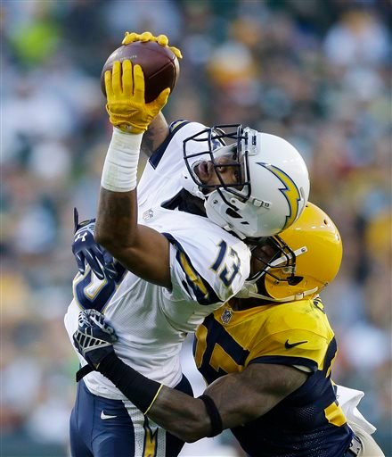 San Diego Chargers' Keenan Allen (13) makes a reception against Green Bay Packers' Sam Shields during the first half of an NFL football game, Sunday, Oct. 18, 2015, in Green Bay, Wis.