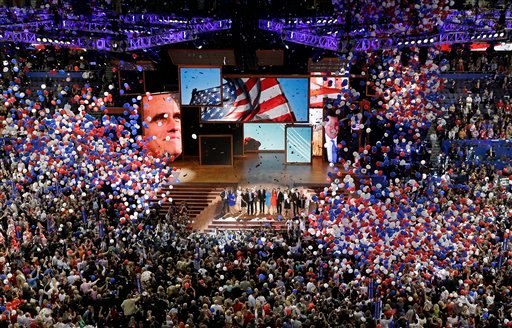 Aug. 30, 2012, file photo, Republican presidential nominee Mitt Romney and vice presidential nominee Rep. Paul Ryan are joined on the stage by their families at the end of the Republican National Convention in Tampa, Fla. (AP Photo/Patrick Semansky, File)