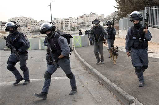 Israeli riot police officers operate in the Arab neighborhood of Issawiyeh in Jerusalem, Tuesday, Oct. 20, 2015. U.N. Secretary-General Ban Ki-moon will make a surprise visit to Israel and the Palestinian territories on Tuesday, in a high-profile gambit t