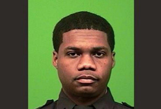 A photo, date not known, provided by the New York Police Department shows police Officer Randolph Holder, who police said died after being shot in the head in a gun battle while pursuing a suspect Tuesday, Oct. 20, 2015, in New York. AP